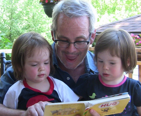 Paul reading to his daughters