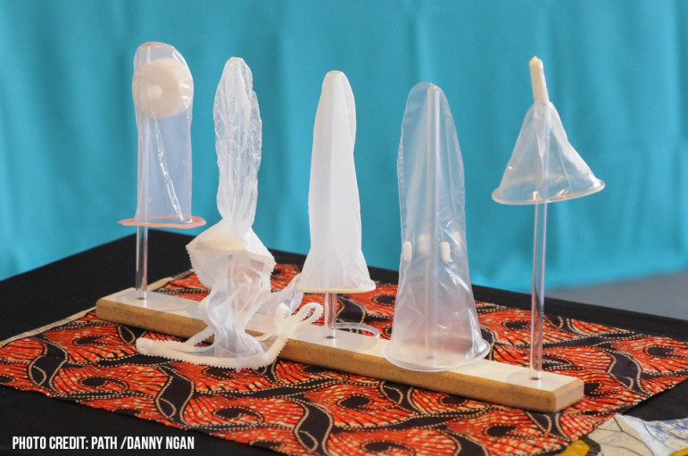 From left to right, the female condom models shown above are: the Cupid, the panty condom (with thong panty attached), the FC2 (with removable inner ring resting on demonstration stand), the Women's Condom (as it unfolds inside the vagina) and the Women's Condom in its capsule, prior to insertion. The Velvet is not shown.