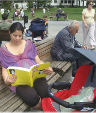 """A Serbian mother reading the Serbian adaptation of """"Our Bodies, Ourselves."""""""