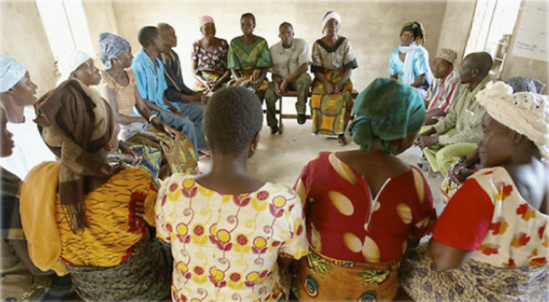 The TAHEA team in conversation with women and men in the community.