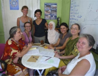 """Gamze Karadağ (standing, right), a liaison for the Turkish """"Our Bodies, Ourselves"""" project, with members of Mavi Kalem."""