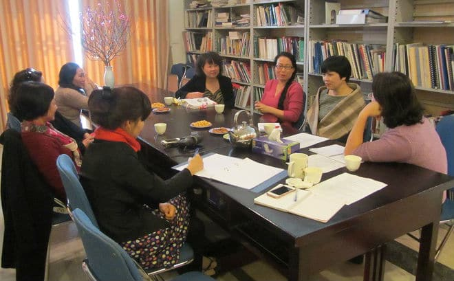 """""""Our Bodies, Ourselves"""" project coordinator Khuat Thu Hong (right, striped scarf) and editorial team members facilitate a discussion with middle-age women about their sexual lives, reproductive health concerns and issues related to menopause."""
