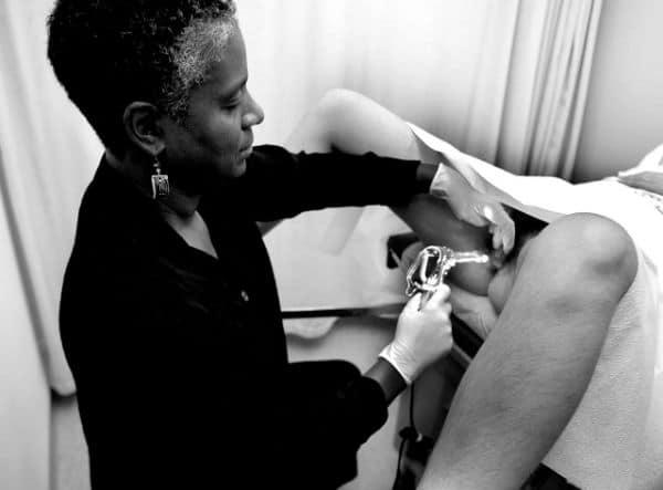 Provider doing a pelvic exam