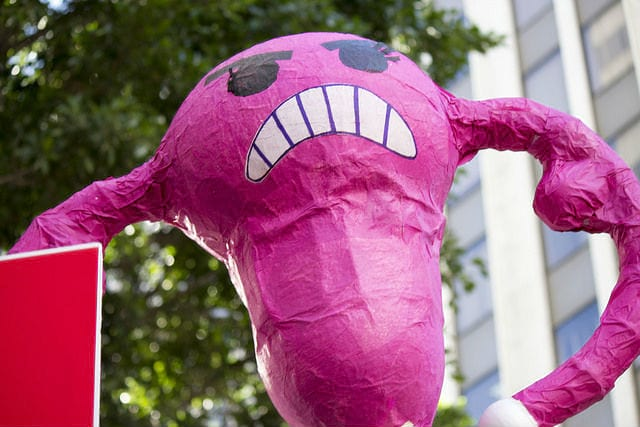 Pink paper mache uterus with a large frown