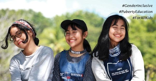 three early teenage girls laughing